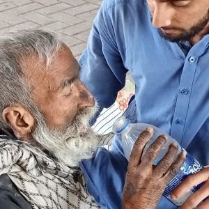 The greatest gift of all is demonstrated by a man giving the sick man a drink.elping the sick.