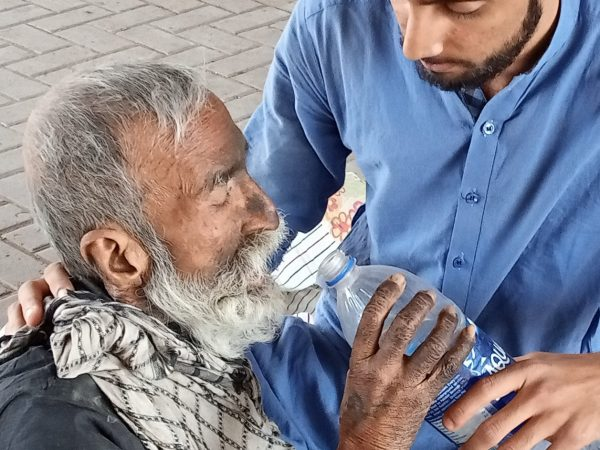 The greatest gift of all is demonstrated by a man giving the sick man a drink. Helping the sick.