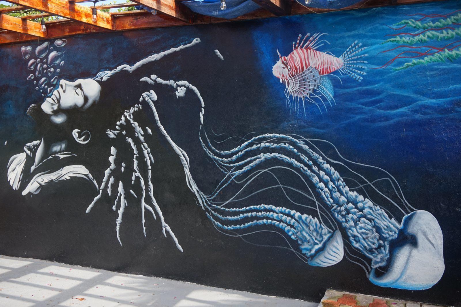 The Bob Marley mural focusing on the underwater scene