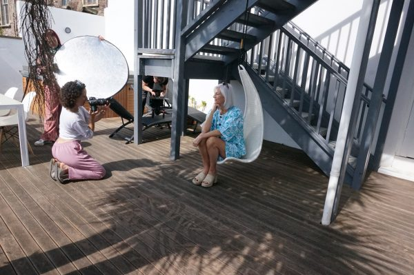 New-season summer Bristol photoshoot Shows the photographer taking a picture of a model