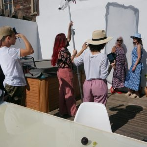 Building a fashion brand Shows film crew taking a picture at fashion photoshoot