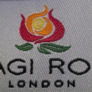 The Magi Rose logo as it appears on our garment labels