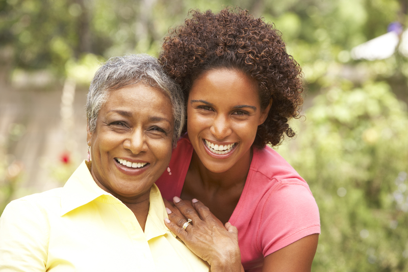 Mother's Day: A history and remembrance is demonstrated by a daughter hugging her mother.