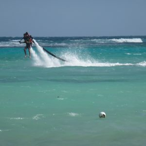 Who is the person behind the Magi in Magi Rose? The picture shows a young man learning to jet ski